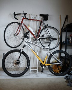 mountain bike and road bike mounted on wall