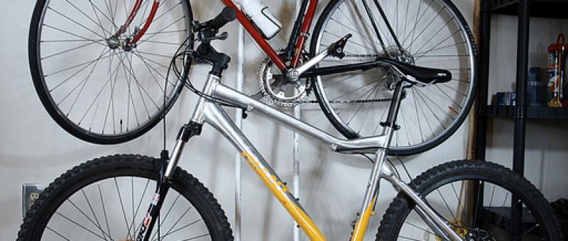 mountain bike and road bike mounted on wall