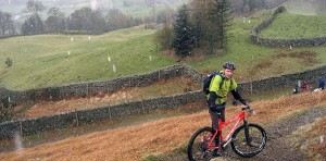 A very wet, snowy day with man mountain biking in Scotland