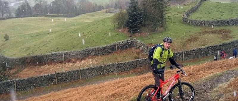 A very wet, snowy day with man mountain biking in Scotland