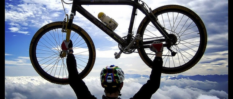 Man holding up a cross country mountain bike