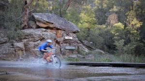 Mountain biking in australia - water crossing in mountain wellington, tasmania